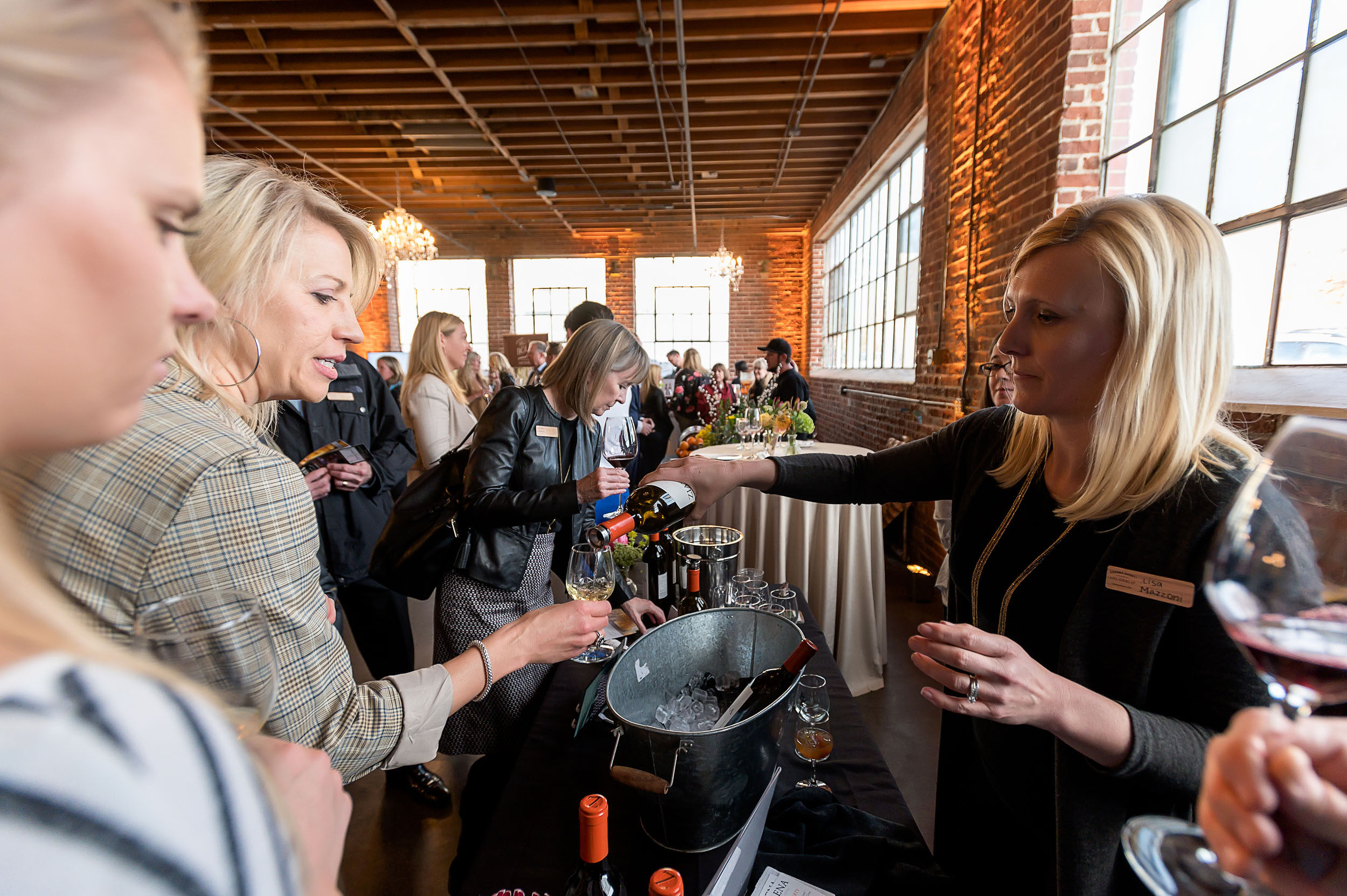 Lisa Pouring at a Denver Event